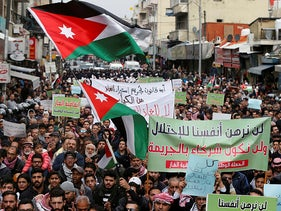 Demonstrators hold Jordanian national flags and chant slogans during a protest against a government's agreement to import natural gas from Israel, in Amman, January 17, 2020.
