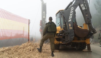 An Israeli soldier with equipment at the Lebanese border.