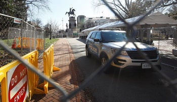 Fencing and magnetometers are set up around Capitol Square for the anticipated pro-gun rally Sunday, Jan. 19, 2020, in Richmond, Va