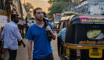 Drew 'Binsky' Goldberg, seen here in Kerala, India, makes a living traveling the world and posting about it on social media.