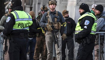 People who are part of an armed militia group arrive near the Virginia State Capitol building to advocate for gun rights in Richmond, Virginia, U.S. January 20, 2020