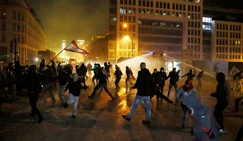 Anti-government demonstrators clash with riot police during an anti-government protest in Beirut, Lebanon, January 18, 2020.