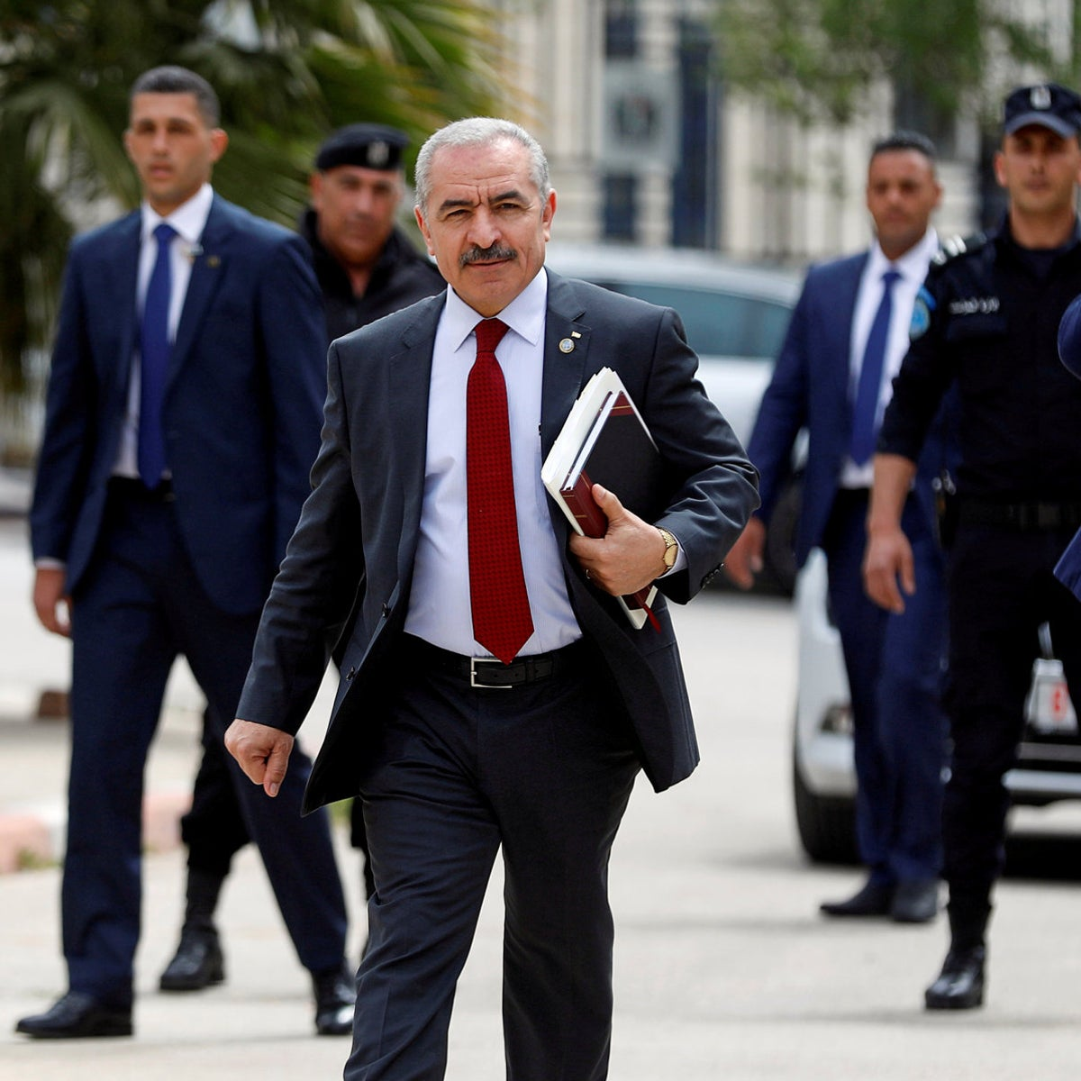 Palestinian Prime Minister Mohammad Shtayyeh arrives for a cabinet meeting in Ramallah, April 15, 2019.