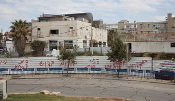 "The site of the proposed homeless shelter in Jaffa. The spray painted barrier reads ""holy site"" and ""cemetery,"" April 16, 2019."