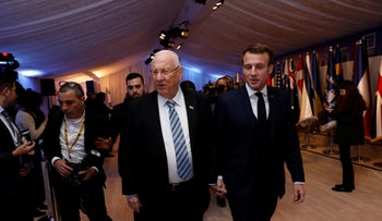 President Reuven Rivlin (L) and his French counterpart Macron at the World Holocaust Forum in Jerusalem, January 22, 2019.