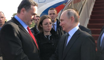 Russian President Vladimir Putin is greeted by Israeli Foreign Minister Yisrael Katz, January 23, 2020.