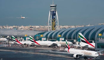 In this Dec. 11, 2019, file photo, an Emirates jetliner comes in for landing at Dubai International Airport in Dubai, United Arab Emirates