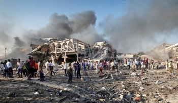 Somalis gather and search for survivors at the scene of a blast in Mogadishu, Somalia, October 14, 2017