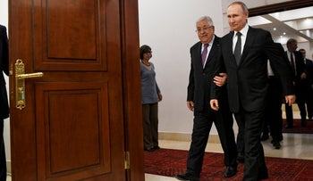 Palestinian President Mahmoud Abbas walks with Russian President Vladimir Putin at the Palestinian Authority headquarters in the West Bank city of Bethlehem, Thursday, Jan 23, 2020.