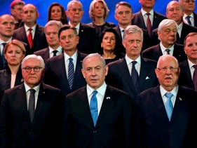 Prime Minister Benjamin Netanyahu and President Reuven Rivlin pose for a group picture with world leaders during the FWorld Holocaust Forum at Yad Vashem in Jerusalem, January 23, 2020.