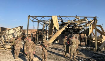 U.S. soldiers inspect the site where an Iranian missile hit at Ain al-Asad air base in Anbar province, Iraq, January 13, 2020