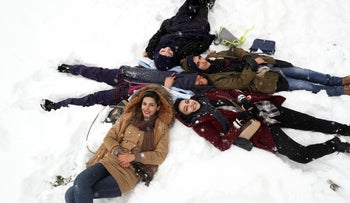 File photo: Women lie on the snow the as they enjoy their time at a park in northern Tehran, Iran, January 19, 2020.
