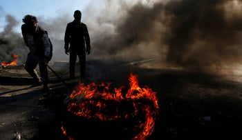 Iraqi demonstrators burn tires to block a road during ongoing anti-government protests in Najaf, Iraq January 26, 2020.