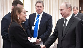 Russian President Vladimir Putin shakes hands with Yaffa Issachar, mother of Israeli citizen Naama Issachar who is jailed in Russia, during their meeting in Tel-Aviv, on Thursday, Jan. 23, 2020.