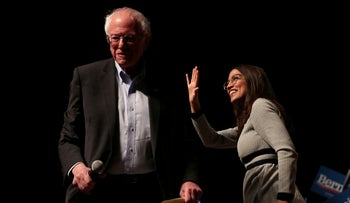 Democratic 2020 U.S. presidential candidate Bernie Sanders arrives at a campaign rally while Rep. Alexandria Ocasio-Cortez waves in Ames, Iowa, U.S., January 25, 2020.