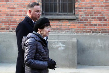 Poland's President Andrzej Duda and Zofia Optulowicz, the daughter of Polish World War II resistance leader Witold Pilecki, attend a ceremony at Auschwitz in Oswiecim, Poland, Jan. 27, 2020.