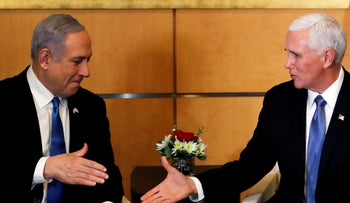 Israeli Prime Minister Benjamin Netanyahu and U.S Vice President Mike Pence prepare to shake hands during their meeting at the U.S embassy in Jerusalem January 23, 2020.