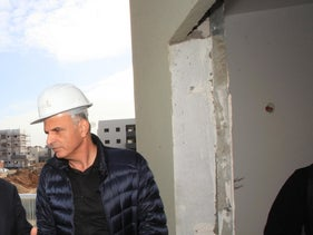 Finance Minister Moshe Kahlon (R) in the southern town of Ofakim, Israel.