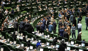 Iranian lawmakers attend a session of parliament in Tehran, Iran, July 16, 2019