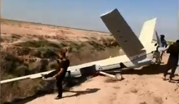 A still of the video posted by Tasnim News Agency showing the Iranian Shahed 129 UAV after emergency landing in a village in southwestern Khuzestan province, January 28, 2020.