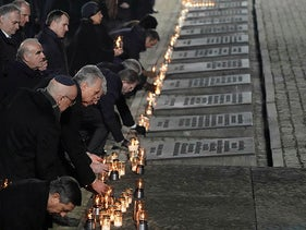 A delegation made up of heads of state and survivors attend a candle lighting ceremony at Auschwitz-Birkenau in Oswiecim, Poland, on January 27, 2020.