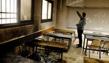 A classroom damaged by fire in Einabus village, near the West Bank city of Nablus, January 28, 2020.