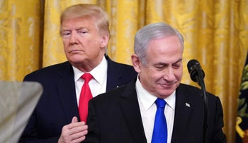 Israeli Prime Minister Benjamin Netanyahu speaking in the White House with U.S. President Donald Trump just behind him, January 28, 2020.