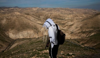 A Jewish shepherd wears a prayer shawl in the Israeli settlement of Mitzpe Yericho in the Jordan Valley in the West Bank on January 27, 2020.