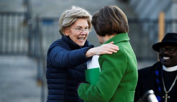 Democratic presidential rivals Elizabeth Warren and Amy Klobuchar say goodbye to each other after Warren's speech at a Martin Luther King Jr. Day rally in Columbia, S.C., on Monday, January 20, 2020.