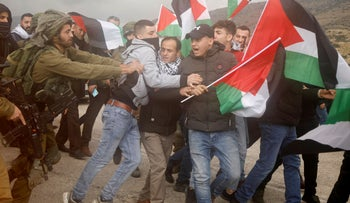 Palestinian demonstrators are pushed back by an Israeli soldier during a protest against the U.S. president Donald Trump?s Middle East peace plan, in Jordan Valley in the Israeli-occupied West Bank January 29, 2020.
