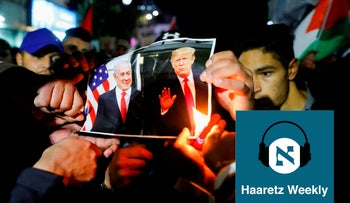 Palestinians burning a photograph of Pres. Trump and PM Netanyahu in the West Bank on Jan 28, 2020