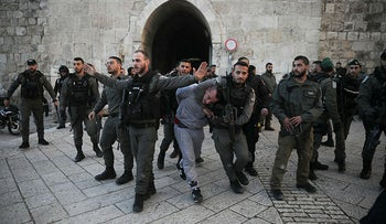 Israeli border police arrests a Palestinian ahead of a protest against Middle East peace plan, in Jerusalem, January 29, 2020.