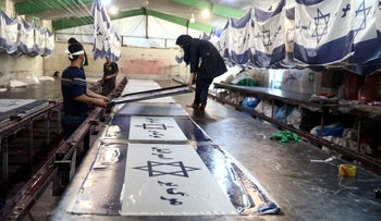 Iranian workers make altered Israeli flags at a large flag factory which creates U.S. and Israeli flags for Iranian protesters to burn in Khomein City, Iran, January 28, 2020.