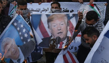 Images of U.S. President Donald Trump and Prime Minister Benjamin Netanyahu being set alight during a demonstrations against the Trump peace plan, in Rafah, Gaza Strip, January 29, 2020.