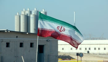 An Iranian flag flutters in Iran's Bushehr nuclear power plant, November 10, 2019
