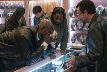"""Kevin Garnett, Lakeith Stanfield and Adam Sandler in a scene from """"Uncut Gems."""""""