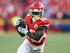 Tyreek Hill of the Kansas City Chiefs running with the ball during a game against the Tennessee Titans, January 19, 2020.