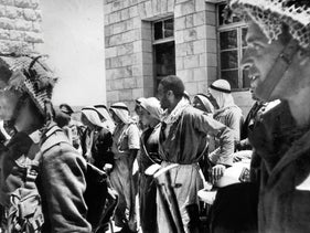 Arabs awaiting a security check in Kfar Qasem, during the War of Independence.