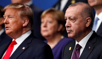 Donald Trump and Tayyip Erdogan pose for a family photo during the annual NATO heads of government summit in Watford, Britain, December 4, 2019.