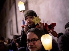 A boy holds a Star of David during a demonstration against anti-Semitism in Mondovi, northwestern Italy, January 24, 2020 .