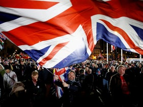 A man waves a British flag on Brexit day in London, Britain January 31, 2020.