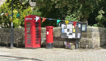 A phone booth and mailbox in Prestbury, Cheshire, England, June 30, 2019