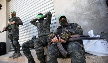 Palestinian fighters with Ezz-Al Din Al-Qassam Brigades, the armed wing of the Hamas, rest during a patrol in Khan Yunis in the southern Gaza Strip on January 26, 2020.