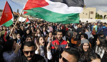 Arab Israelis wave Palestinian flags as they take part in a rally to express their opposition to the peace plan in the Arab-Israeli town of Baqa al-Gharbiya in northern Israel, February 1, 2020.