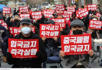 South Korean protesters stage a rally calling for a ban on Chinese people entering South Korea near the presidential Blue House in Seoul, South Korea, January 29, 2019.