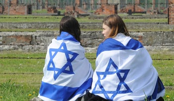 Illustrative image: Israeli teens draped in flags at a ceremony in Auschwitz, 2016.