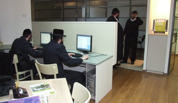Ultra-Orthodox men at work are seen in a photo for illustrative purposes only.