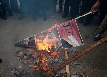 Angry Palestinian protesters set portraits of the king of Bahrain, prime minister of UAE and Oman's new Sultan during a protest against Trump's peace plan. Hebron, West Bank, Jan 30, 2020