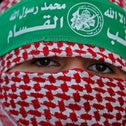 A masked Palestinian Hamas supporter attends a rally marking the 32nd anniversary of Hamas founding, in Gaza City December 14, 2019