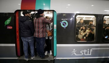 Passengers on a packed metro train at the Gare du Nord RER station, Paris, December 10, 2019.